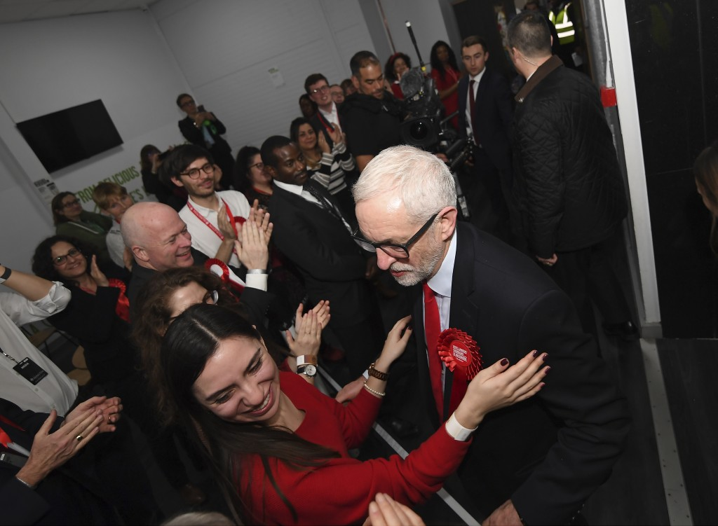British opposition Labour Party leader Jeremy Corbyn greets party activists as he arrives for the declaration of his seat in the 2019 general election...