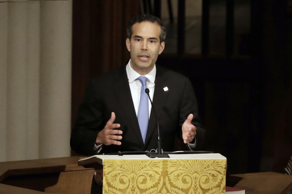 FILE - In this Dec. 6, 2018 file photo, George P. Bush pauses as he gives a eulogy during a funeral for former President George H.W. Bush at St. Marti...