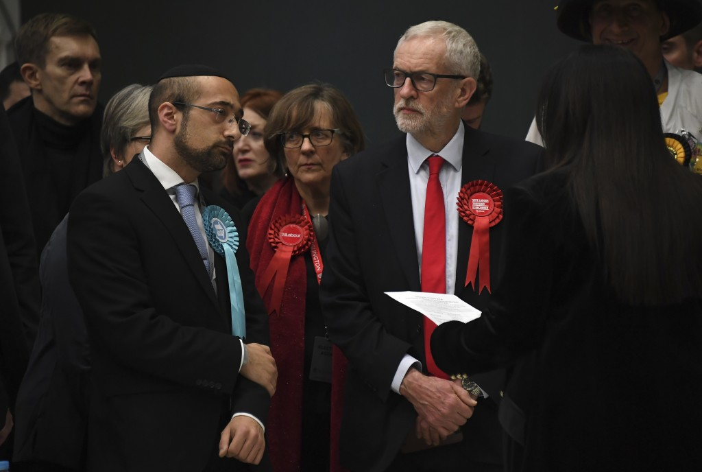 British opposition Labour Party leader Jeremy Corbyn, right,  waits for the declaration of his seat in the 2019 general election in Islington, London,...