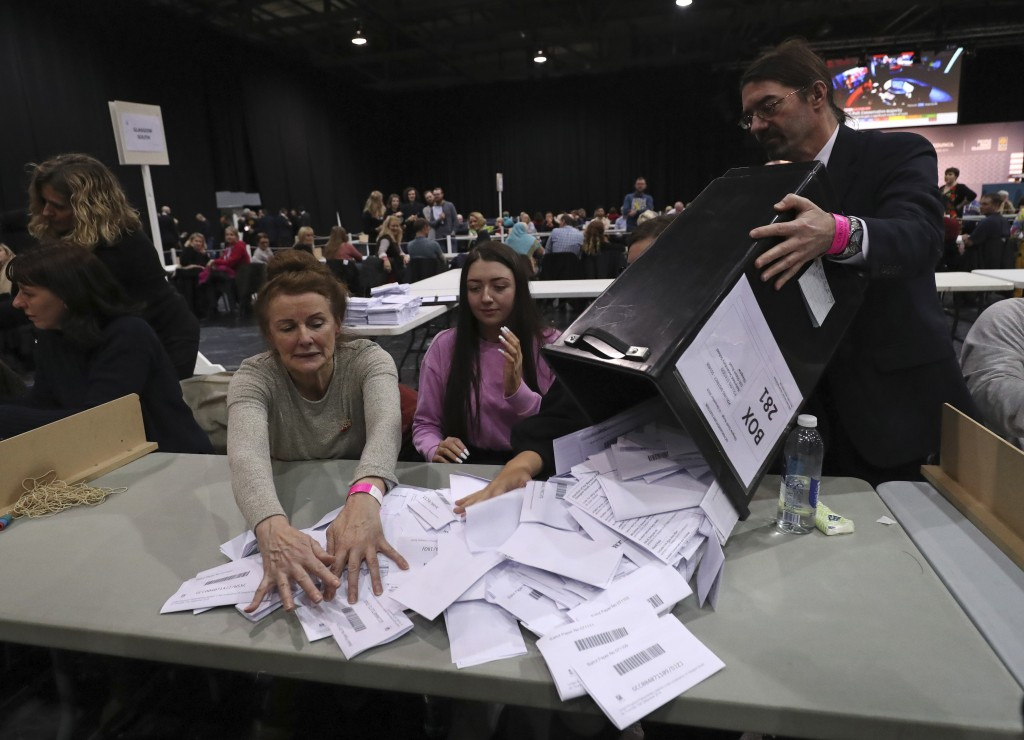 The first ballot box to arrive at the SEC Centre in Glasgow is emptied onto a table for staff to begin counting in the 2019 General Election, Thursday...