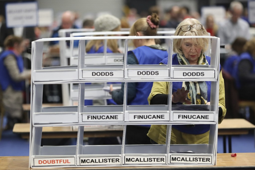 Counters at work during the count at the Titanic exhibition centre, Belfast, Northern Ireland for the 2019 General Election Thursday Dec. 12, 2019. (L...