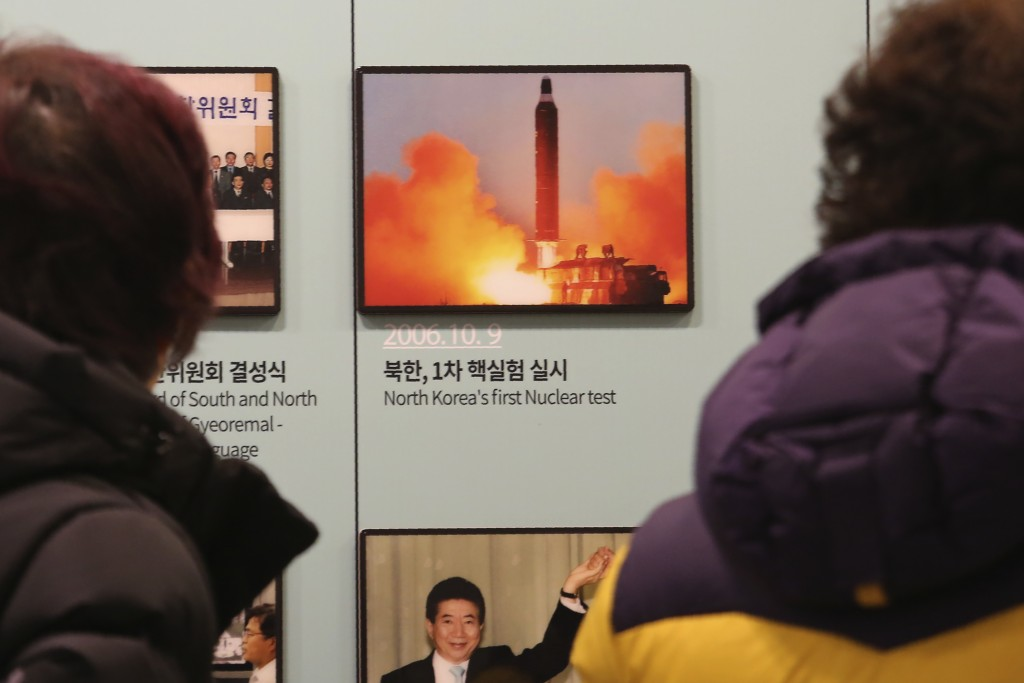 Visitors watch a photo showing North Korea's missile launch at the Unification Observation Post in Paju, South Korea, near the border with North Korea...