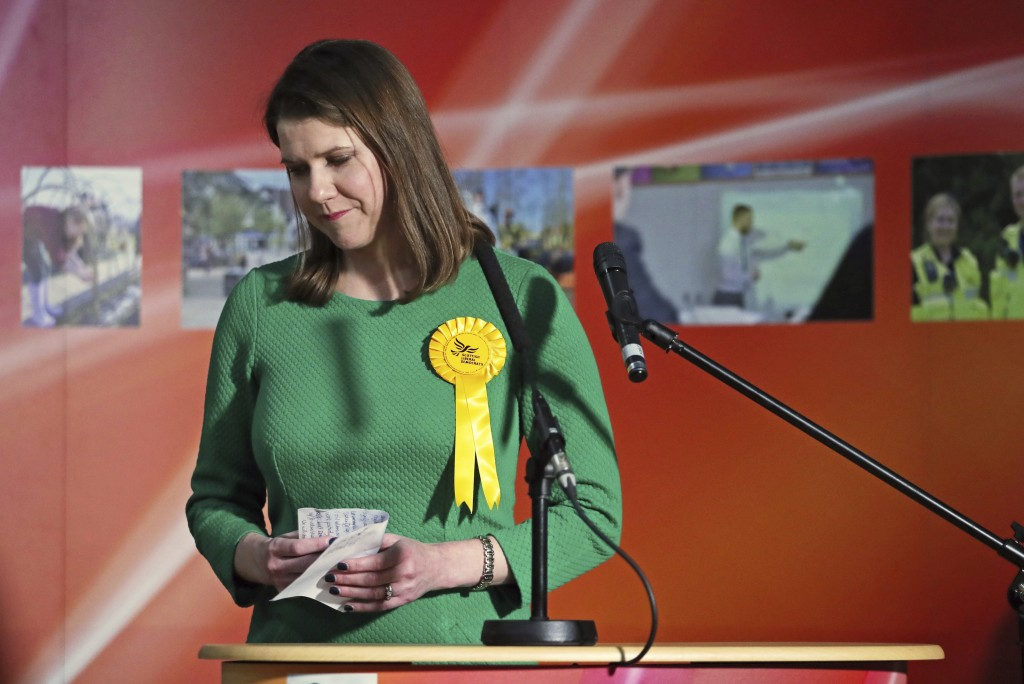 Lib Dem leader Jo Swinson, second right, reacts as she loses her East Dumbartonshire constituency, during the count at the Leisuredome, Bishopbriggs, ...