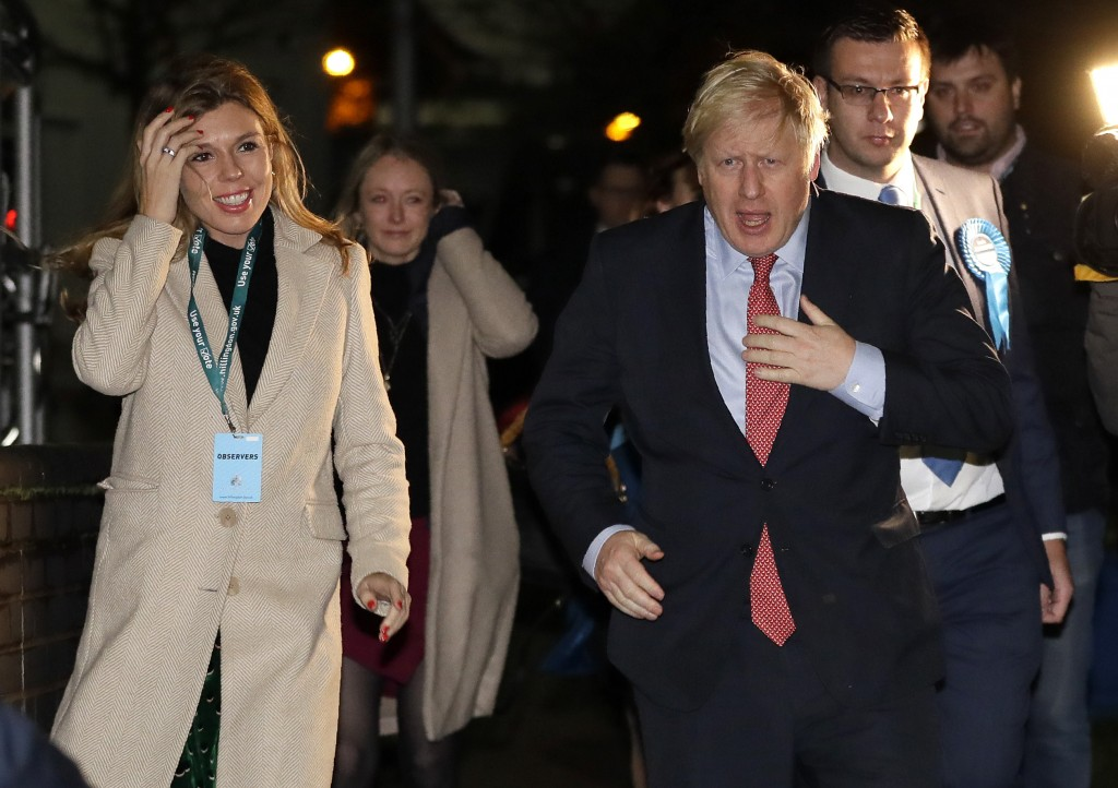 Britain's Prime Minister and Conservative Party leader Boris Johnson and his partner Carrie Symonds arrives for the Uxbridge and South Ruislip constit...