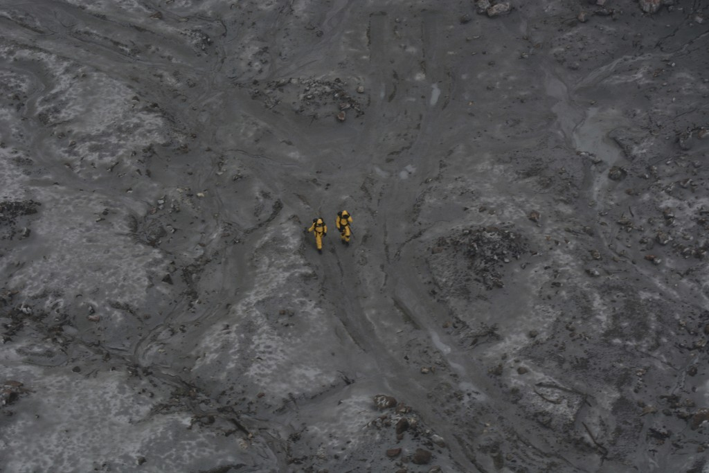 This photo released by the New Zealand Defence Force shows an operation to recover bodies from White Island after a volcanic eruption in Whakatane, Ne...