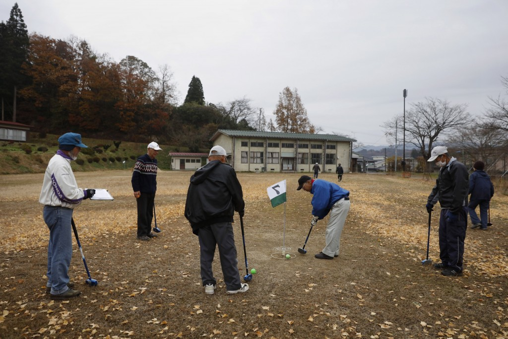 A group of seniors play gateball in a school yard Wednesday, Nov. 27, 2019, in Date, Fukushima prefecture, Japan. The torch relay for the Tokyo Olympi...