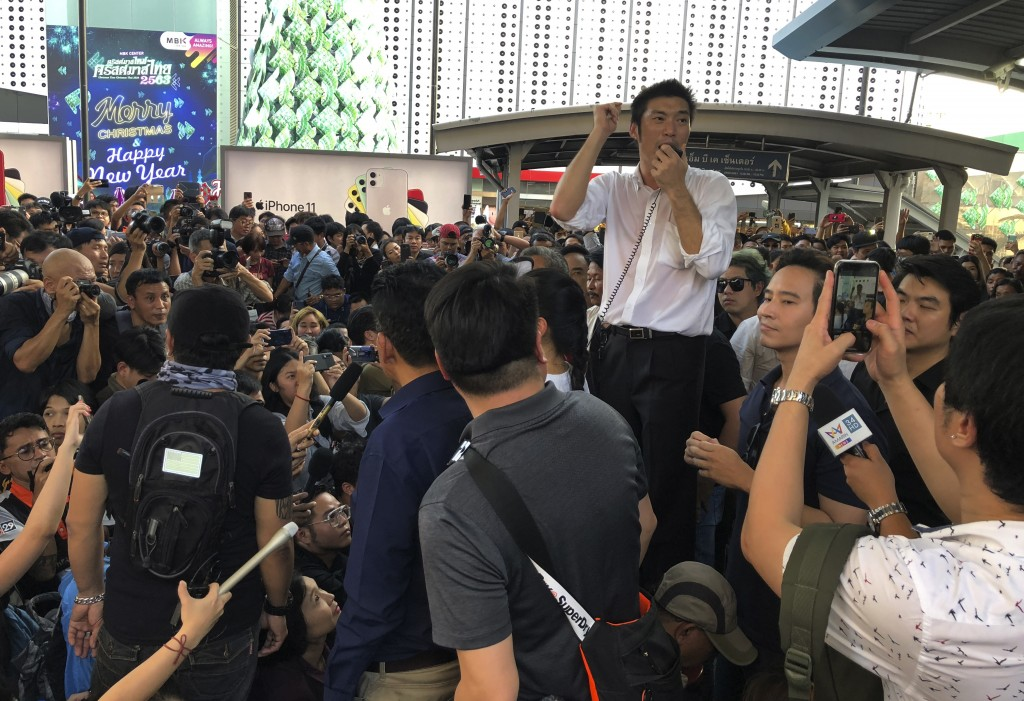 Thailand's Future Forward Party leader Thanathorn Juangroongruangkit talks to his supporters during a rally in Bangkok, Thailand, Saturday, Dec. 14, 2...