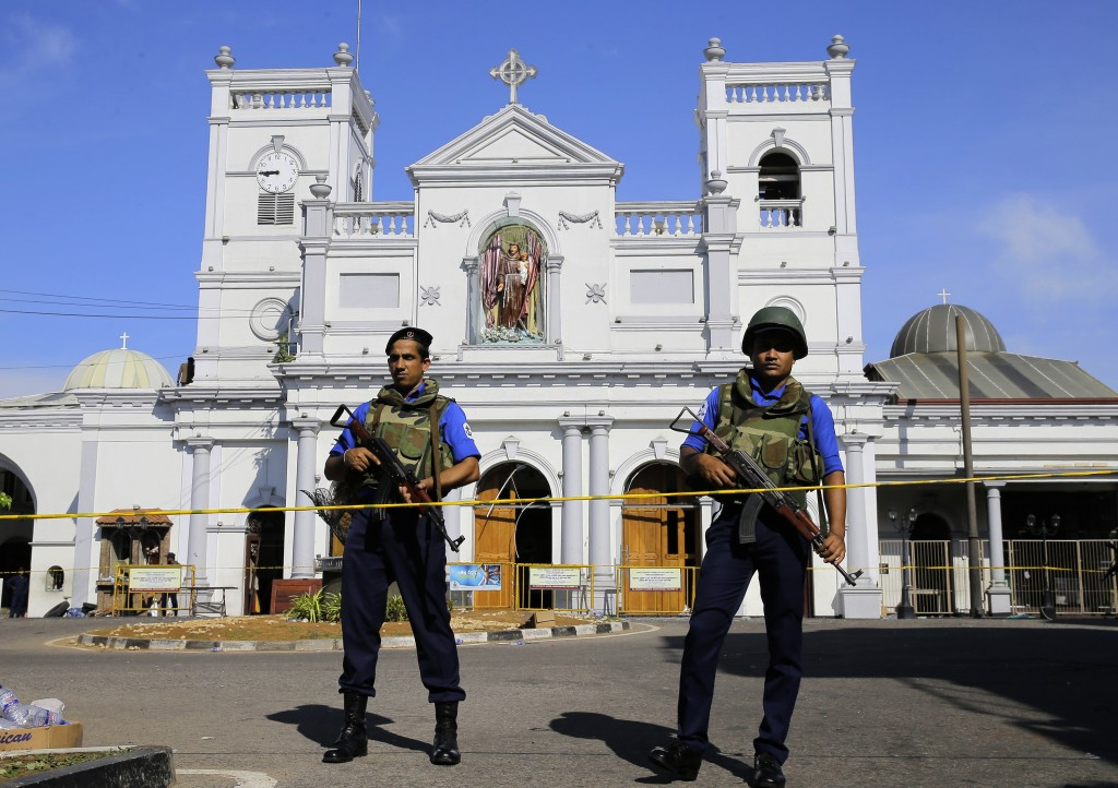 FILE - In this April 22, 2019, file photo, Sri Lankan Navy soldiers stand guard in front of the St. Anthony's Shrine in Colombo, Sri Lanka. On Easter ...