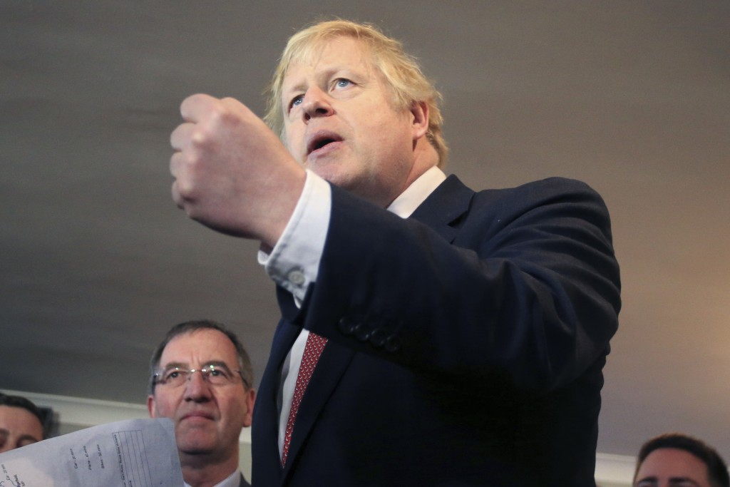 Britain's Prime Minister Boris Johnson, gestures as he speaks to supporters on a visit to meet newly elected Conservative party MP for Sedgefield, Pau...