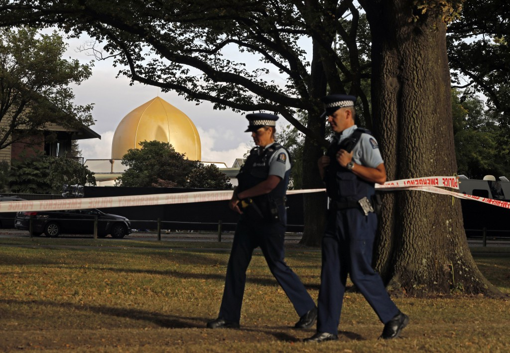 FILE - In this March 20, 2019, file photo, police officers patrol at a park outside the Al Noor mosque in Christchurch, New Zealand. On March 15, 2019...
