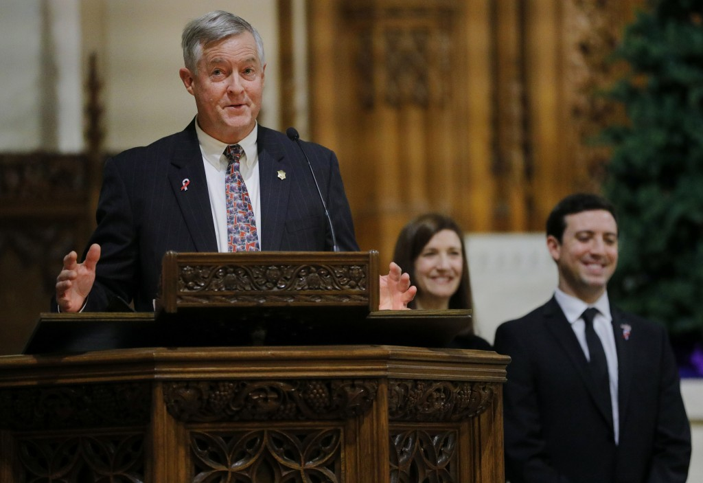 John Frates Jr., accompanied by Jennifer Mayo and Andrew Frates, delivers the eulogy during a funeral mass for his son Pete Frates at St. Ignatius of ...