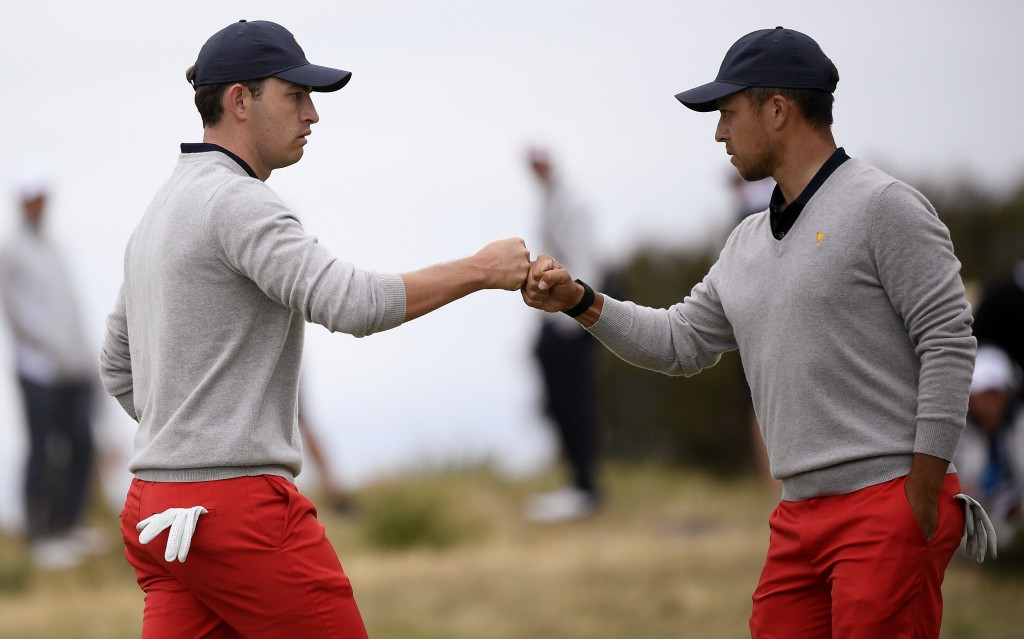 U.S. team player Xander Schauffele, left, fist bumps with playing partner Patrick Cantlay in their foursome match during the President's Cup golf tour...