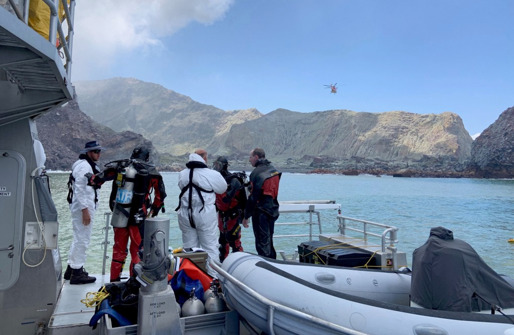 Police divers prepare to search the waters near White Island off the coast of Whakatane, New Zealand, Saturday Dec. 14, 2019. A team of nine from the ...