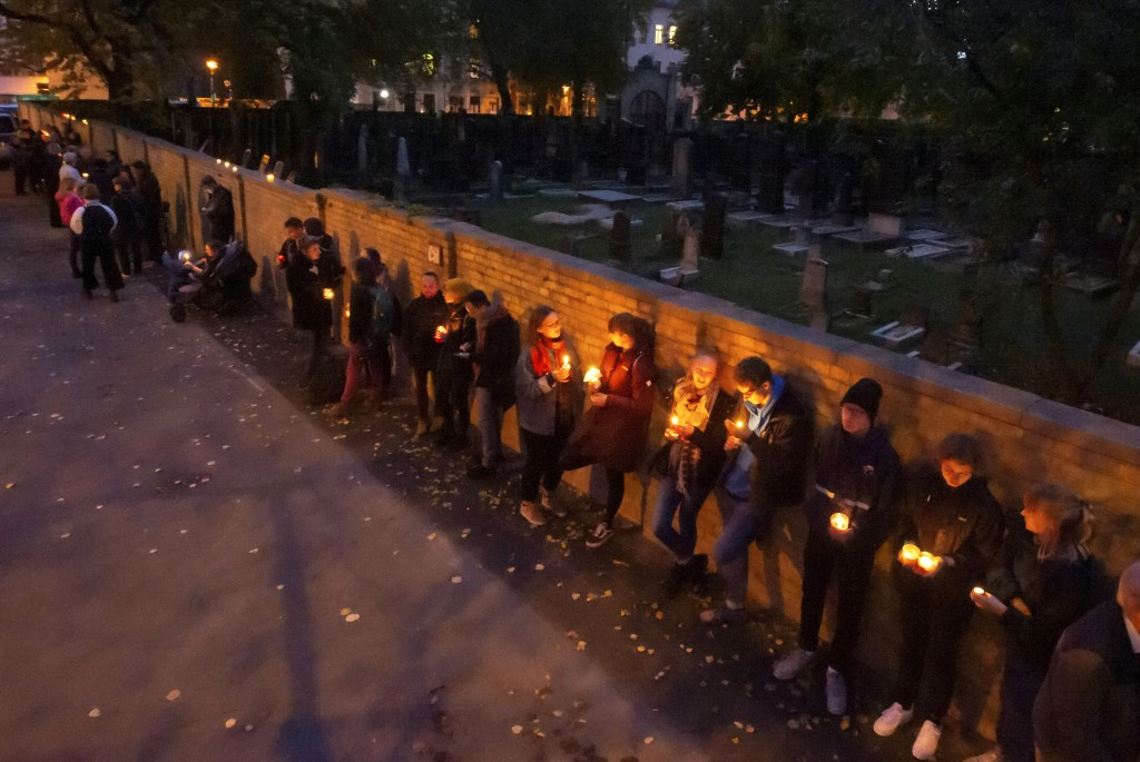 FILE - In this Oct. 11, 2019, file photo, people line up for a human chain around the Jewish synagogue and the cemetery during the Sabbath celebration...