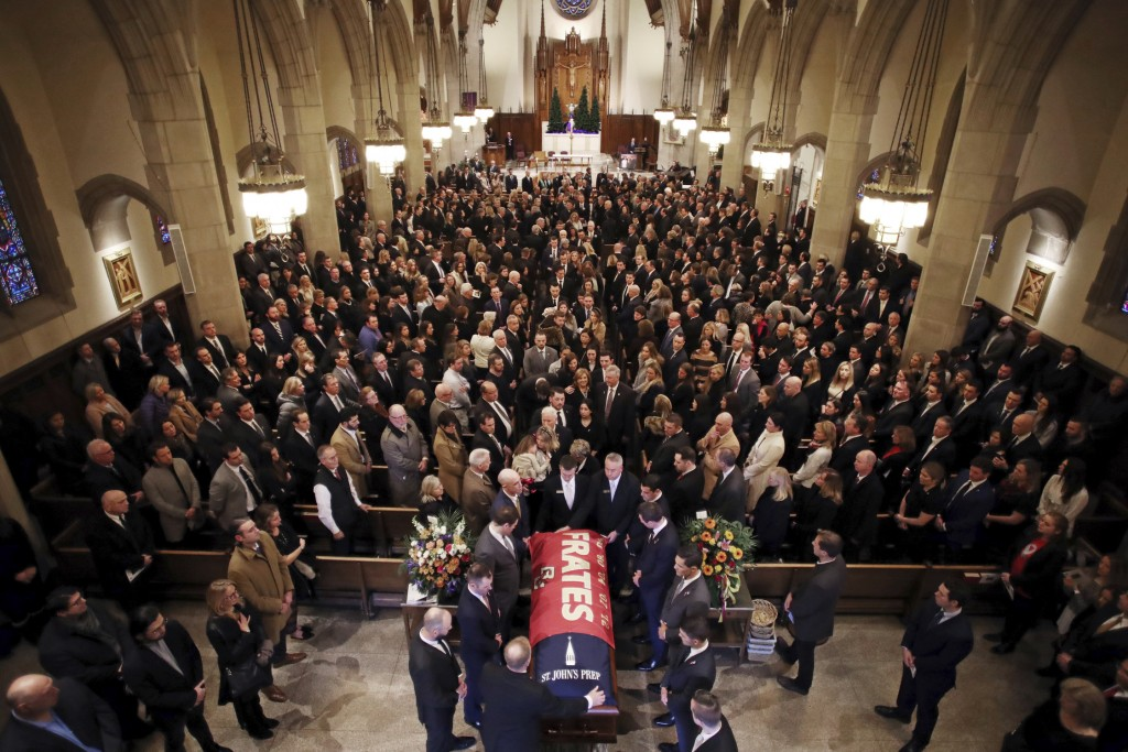 The procession follows the casket of Pete Frates, draped in a flag bearing his name, during a funeral mass at St. Ignatius of Loyola Parish church at ...