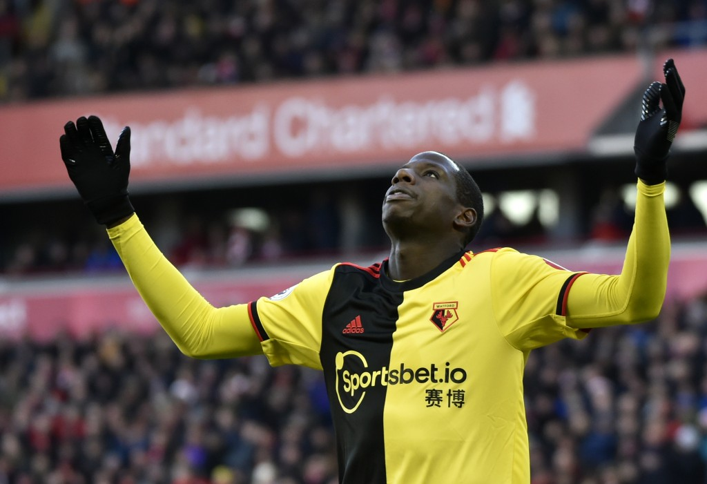 Watford's Abdoulaye Doucoure gestures after missing a chance to score during the English Premier League soccer match between Liverpool and Watford at ...