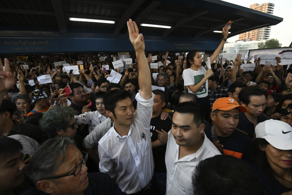 Thailand's Future Forward Party leader Thanathorn Juangroongruangkit gestures as he talks to his supporters during rally in Bangkok, Thailand, Saturda...