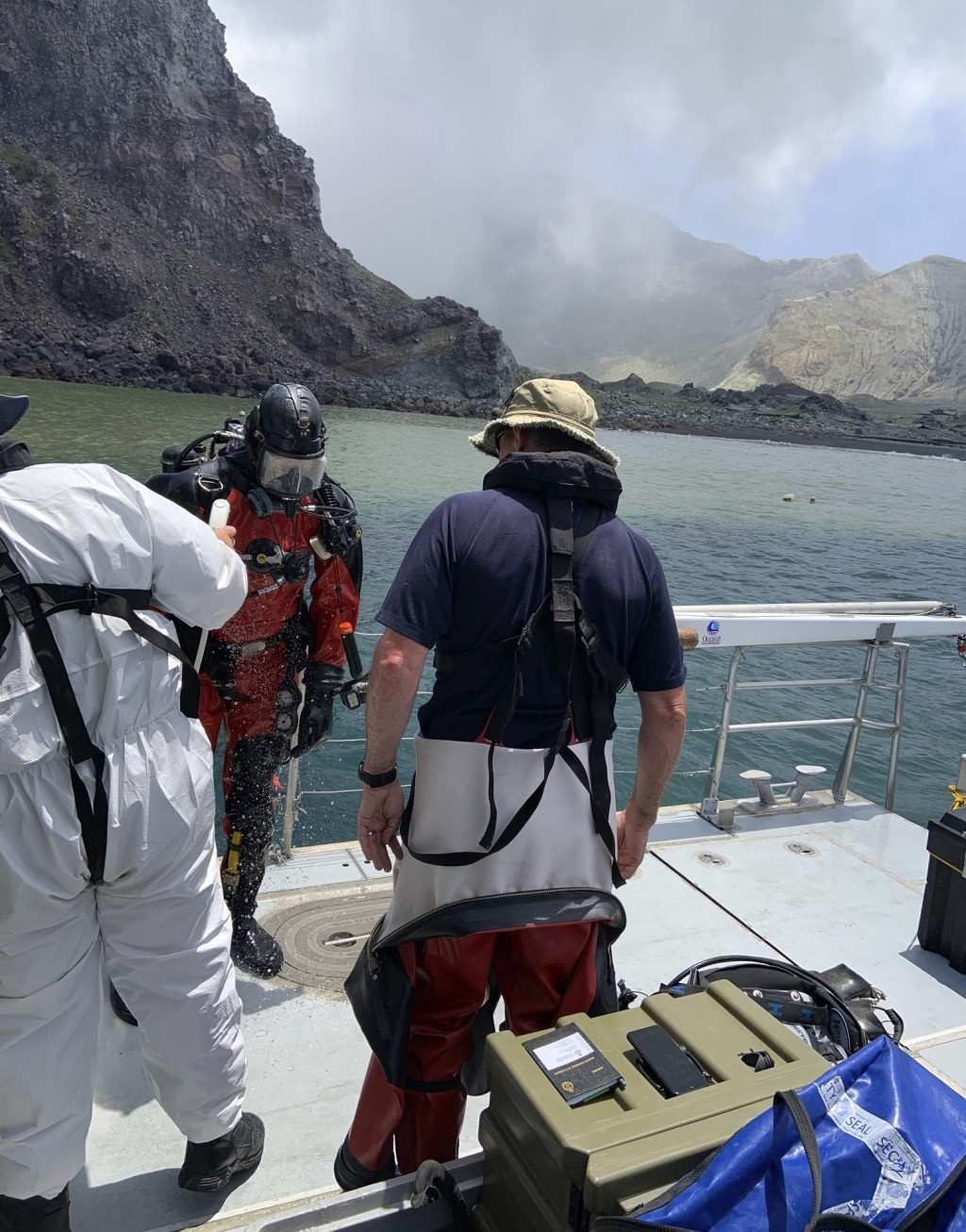 Police divers prepare to search the waters near White Island off the coast of Whakatane, New Zealand, Saturday Dec.14, 2019. A team of nine from the P...