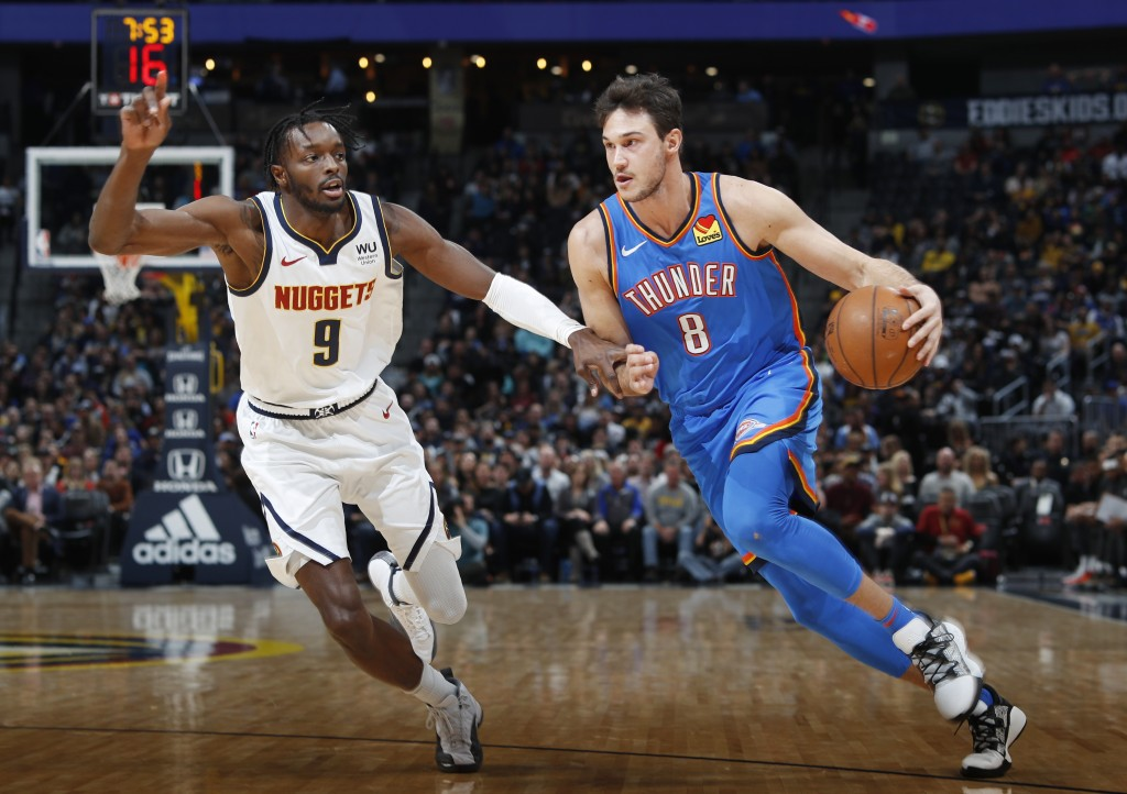 Oklahoma City Thunder forward Danilo Gallinari, right, drives to the rim past Denver Nuggets forward Jerami Grant in the first half of an NBA basketba...