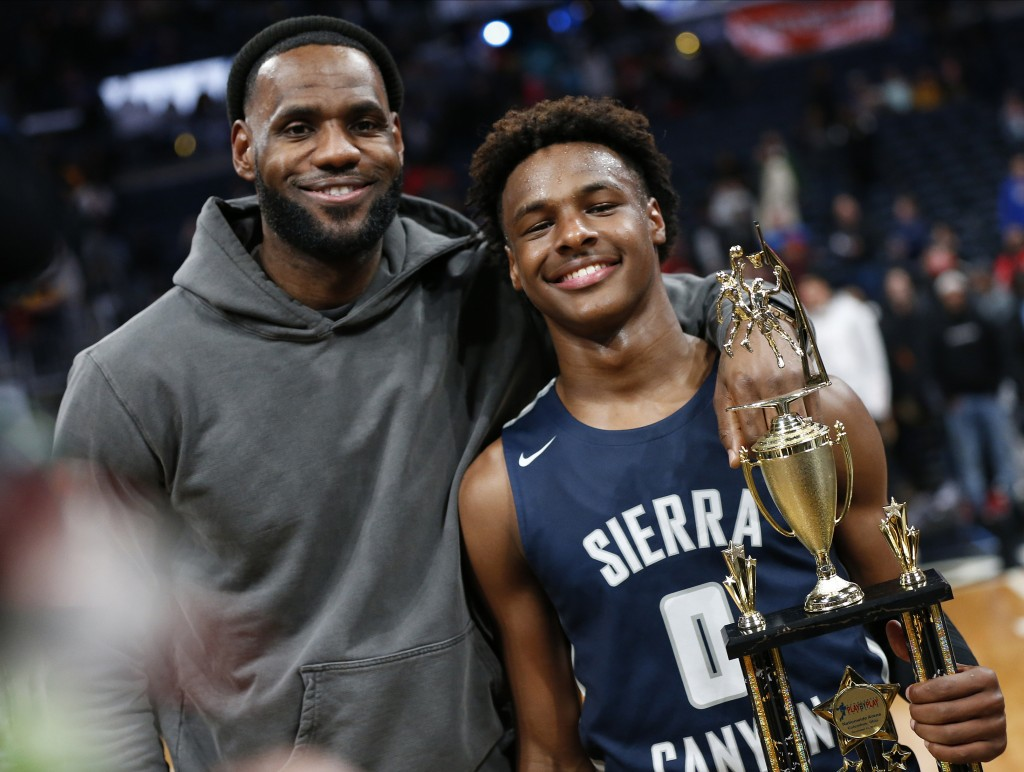 LeBron James, left, poses with his son Bronny after Sierra Canyon beat Akron St. Vincent - St. Mary in a high school basketball game, Saturday, Dec. 1...