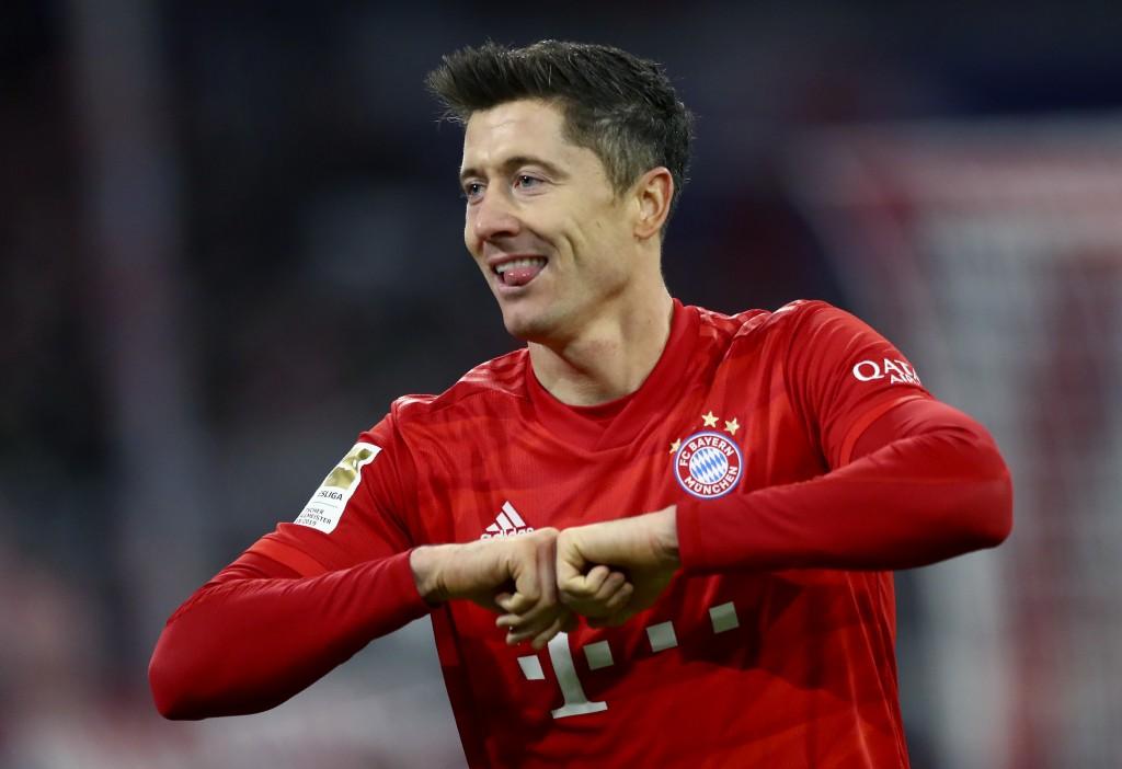 Bayern's Robert Lewandowski celebrates after scoring his side's fourth goal during the German Bundesliga soccer match between FC Bayern Munich and SV ...