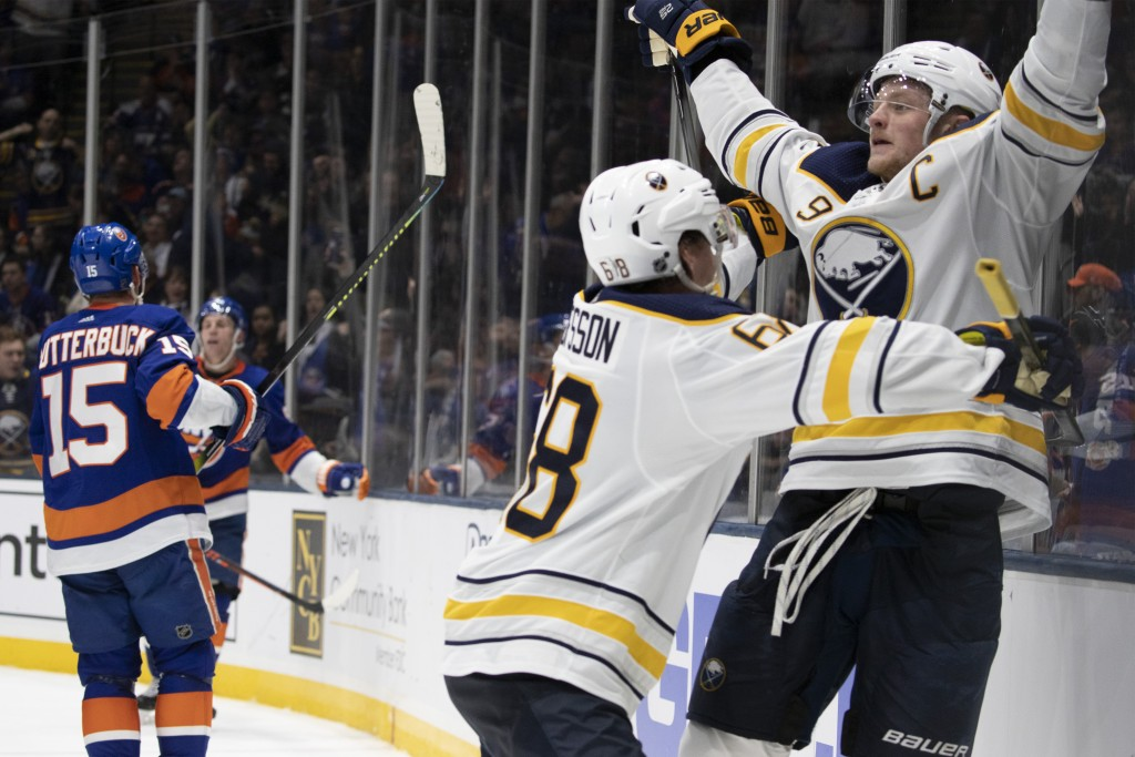 Buffalo Sabres center Jack Eichel (9) celebrates his third period goal with left wing Victor Olofsson (68) during an NHL hockey game, Saturday, Dec. 1...