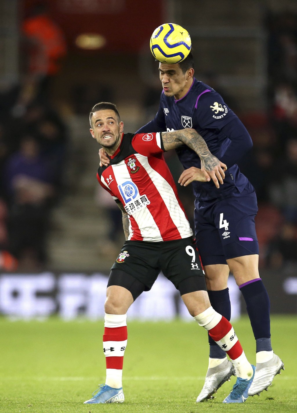 Southampton's Danny Ings, left, and West Ham United's Fabian Balbuena during their English Premier League soccer match at St Mary's Stadium in Southam...
