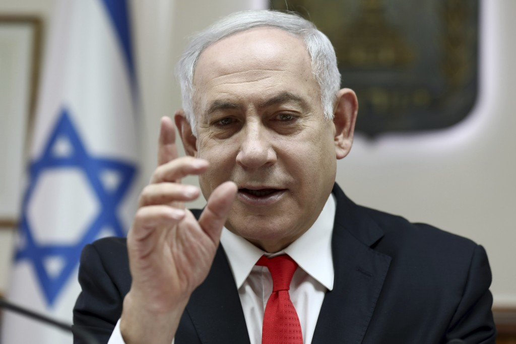 Israeli Prime Minister Benjamin Netanyahu reacts during the weekly cabinet meeting, at his office in Jerusalem, Sunday, Dec. 15, 2019. (Gali Tibbon/Po...