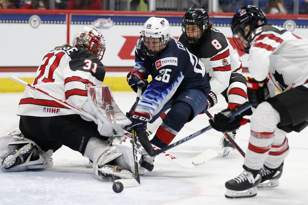 Canada's Geneviève Lacasse (31) blocks a shot by United States' Kendall Coyne Schofield (26) during the third period of a rivalry series women's hocke...