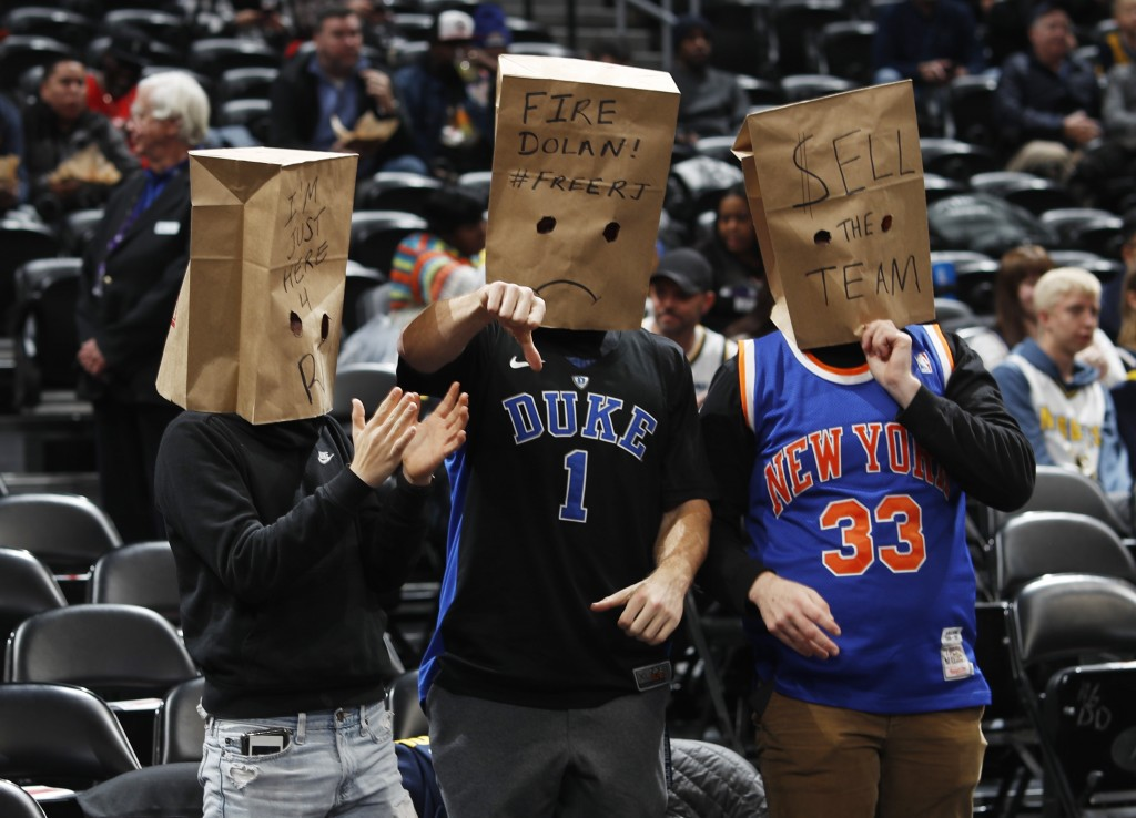New York Knicks fans wear paper bags on their heads as the Knicks take the court to face the Denver Nuggets in an NBA basketball game Sunday, Dec. 15,...