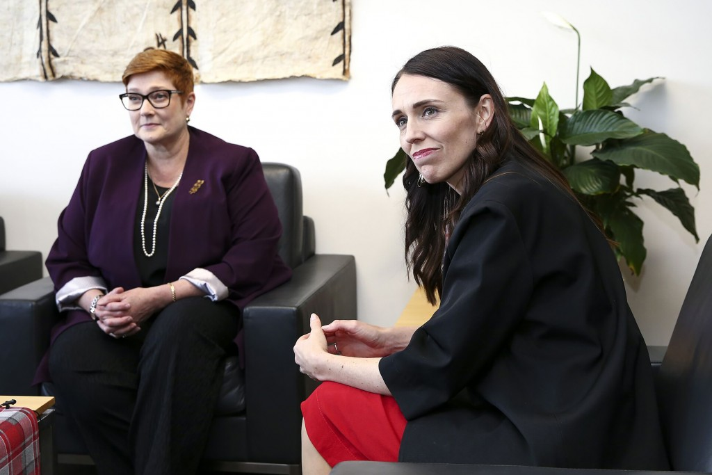 CORRECTS SPELLING TO MARISE INSTEAD OF MARISA - New Zealand Prime Minister Jacinda Ardern, right, sits with Australian Foreign Minister Marise Payne d...