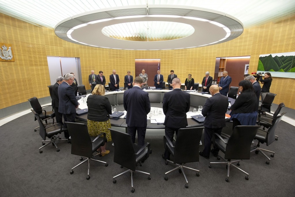 New Zealand Prime Minister Jacinda Ardern and her cabinet observe a moment of silence at the moment that a volcano erupted a week earlier, killing 18 ...
