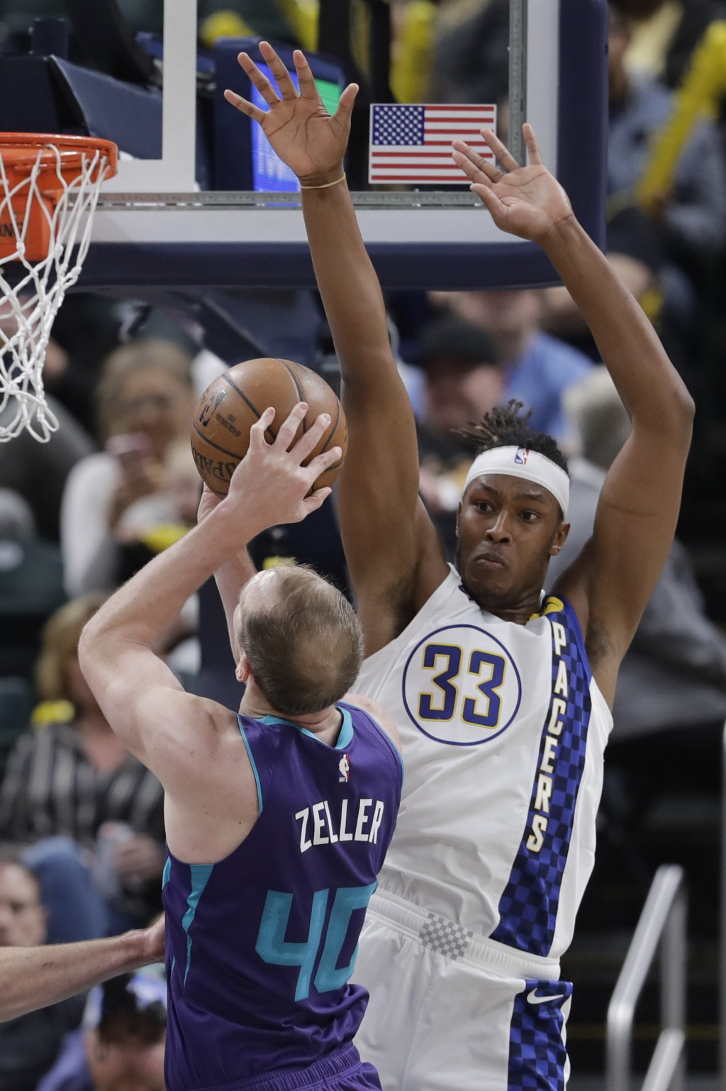 Charlotte Hornets' Cody Zeller (40)  shoots against Indiana Pacers' Myles Turner (33) during the second half of an NBA basketball game, Sunday, Dec. 1...