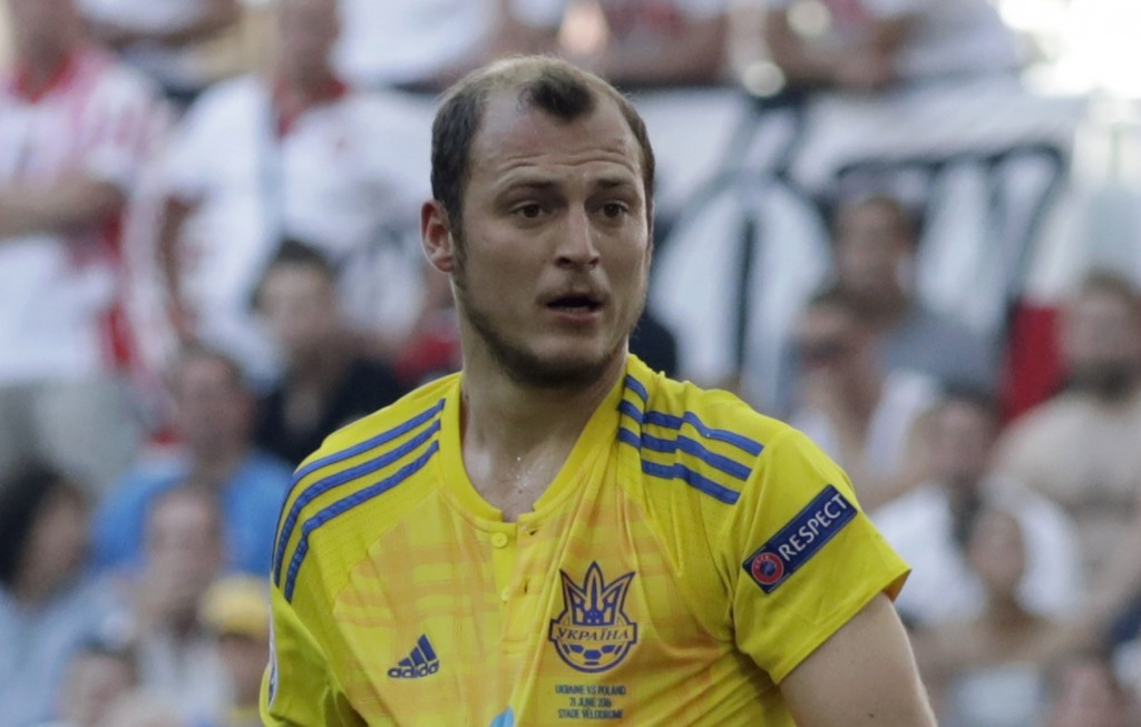 FILE - In this Tuesday, June 21, 2016 file photo, Ukraine's Roman Zozulya protest to a referee during the Euro 2016 Group C soccer match between Ukrai...
