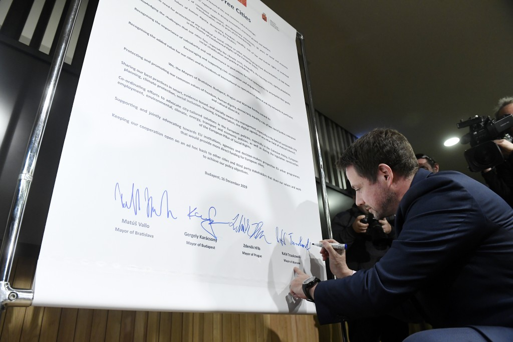 Mayor of Warsaw Rafal Trzaskowski signs the Pact of Free Cities during a meeting of the mayors of the capitals of the Visegrad Four or V4 countries Cz...