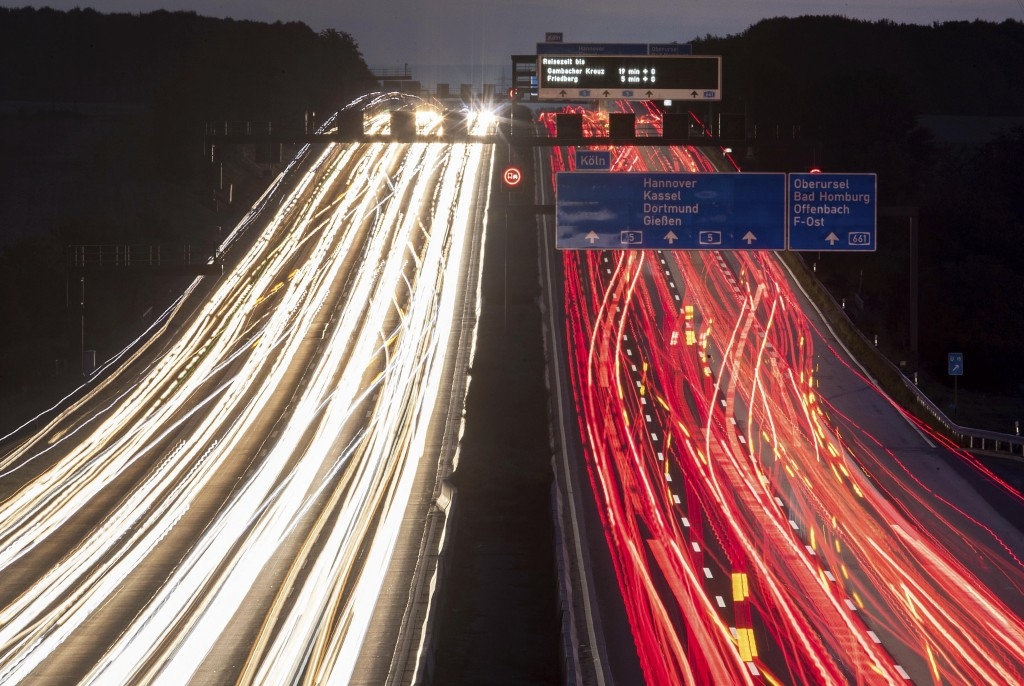 FILE -- In this Thursday, Sept. 19, 2019 long time exposure photo cars drive on a highway in Frankfurt, Germany. Germany's parliament is poised to mor...