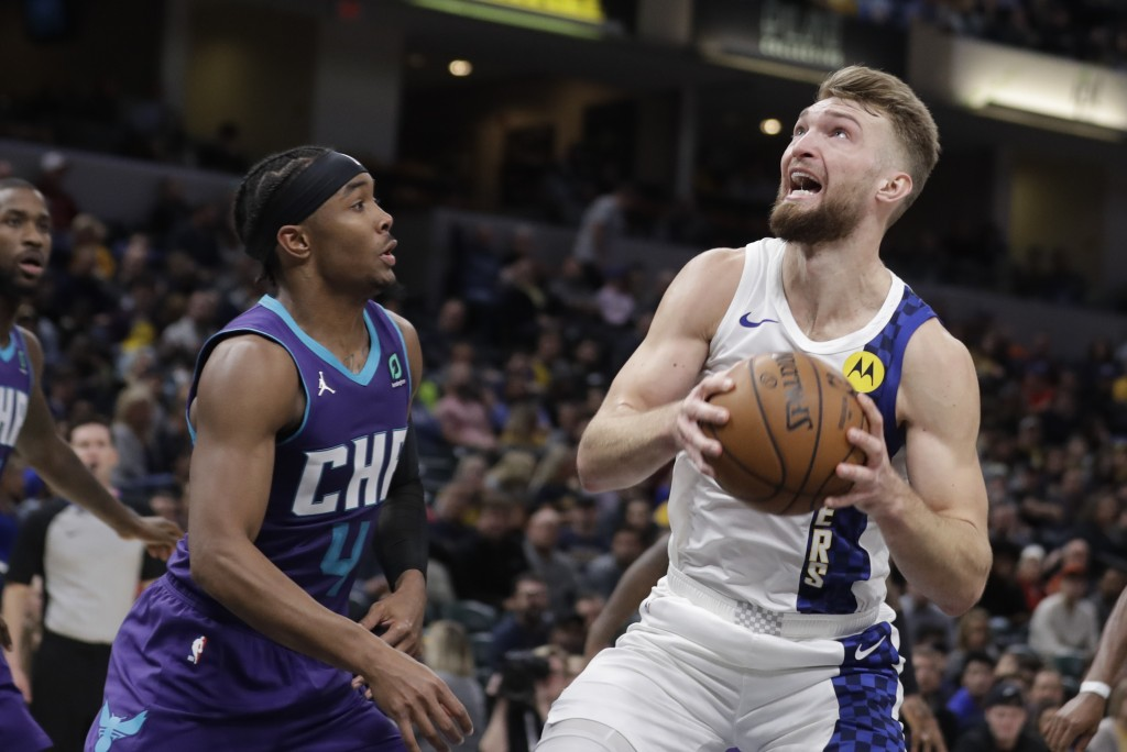 Indiana Pacers' Domantas Sabonis, right, goes to the basket against Charlotte Hornets' Devonte' Graham (4) during the second half of an NBA basketball...