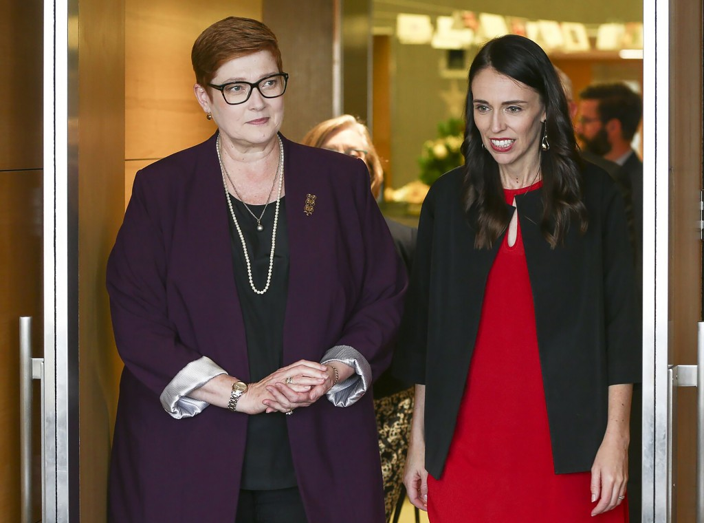CORRECTS SPELLING TO MARISE INSTEAD OF MARISA - New Zealand Prime Minister Jacinda Ardern, right, greets Australian Foreign Minister Marise Payne in W...