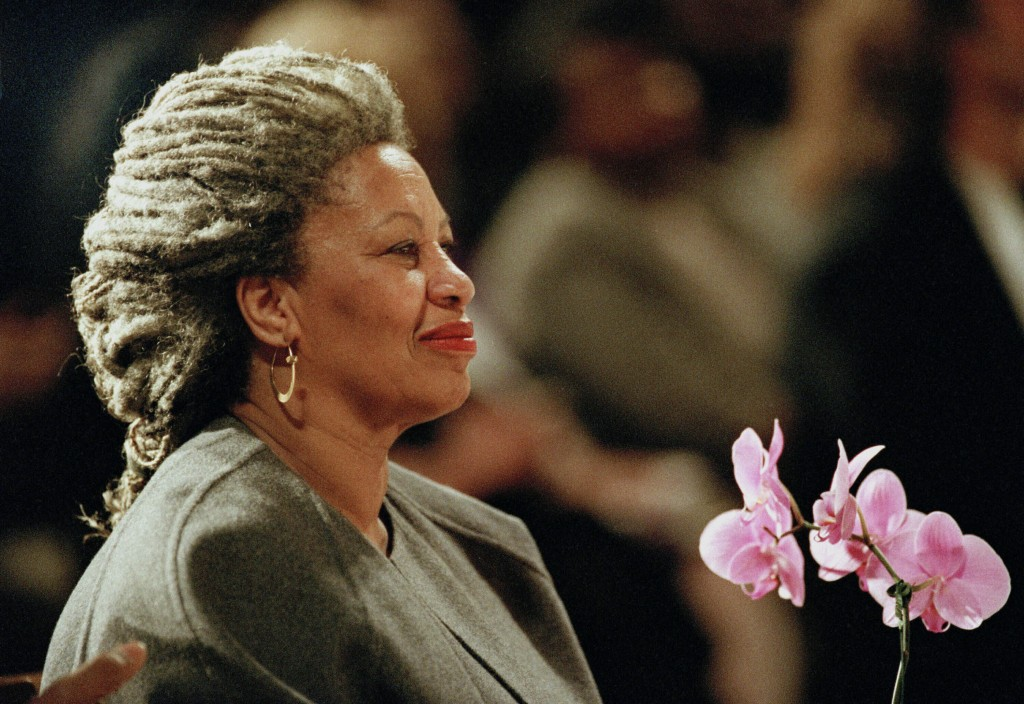 FILE - In this April 5, 1994, file photo, Toni Morrison as she holds an orchid at the Cathedral of St. John the Divine in New York. Publisher Alfred A...