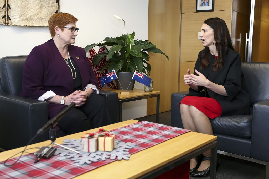 CORRECTS SPELLING TO MARISE INSTEAD OF MARISA - New Zealand Prime Minister Jacinda Ardern, right, speaks to Australian Foreign Minister Marise Payne d...