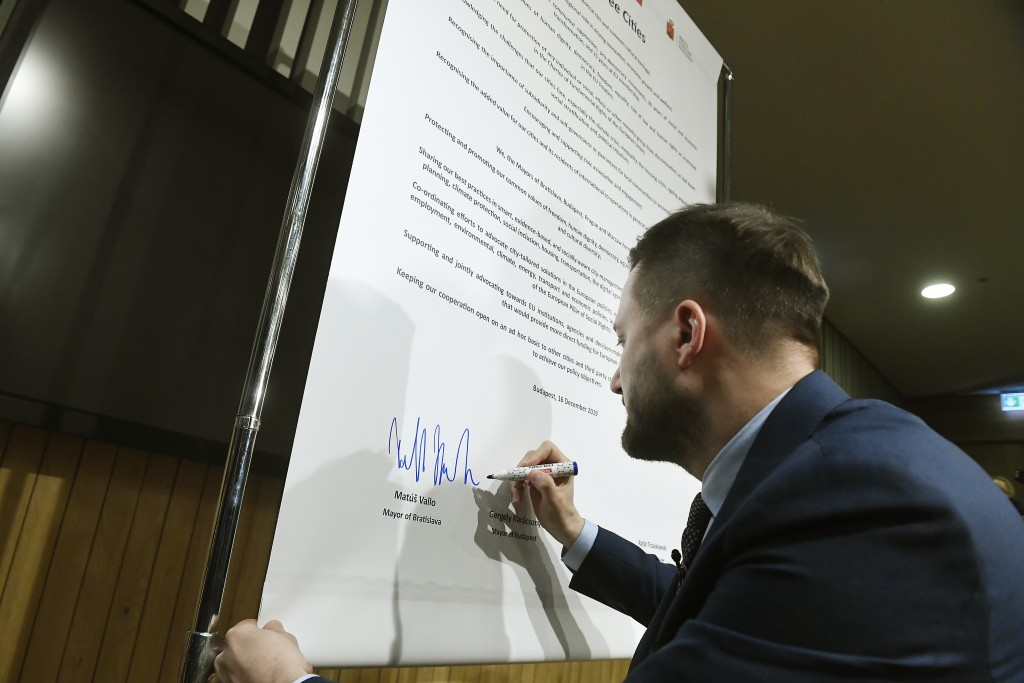 Mayor of Bratislava Matus Vallo signs the Pact of Free Cities during a meeting of the mayors of the capitals of the Visegrad Four or V4 countries Czec...