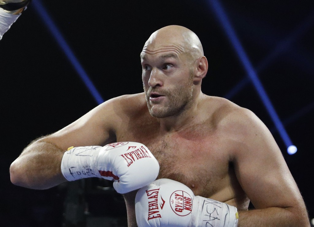 FILE - In this file photo dated Saturday, June 15, 2019, Tyson Fury, of England in action against Tom Schwarz of Germany, in Las Vegas, USA.  Tyson Fu...