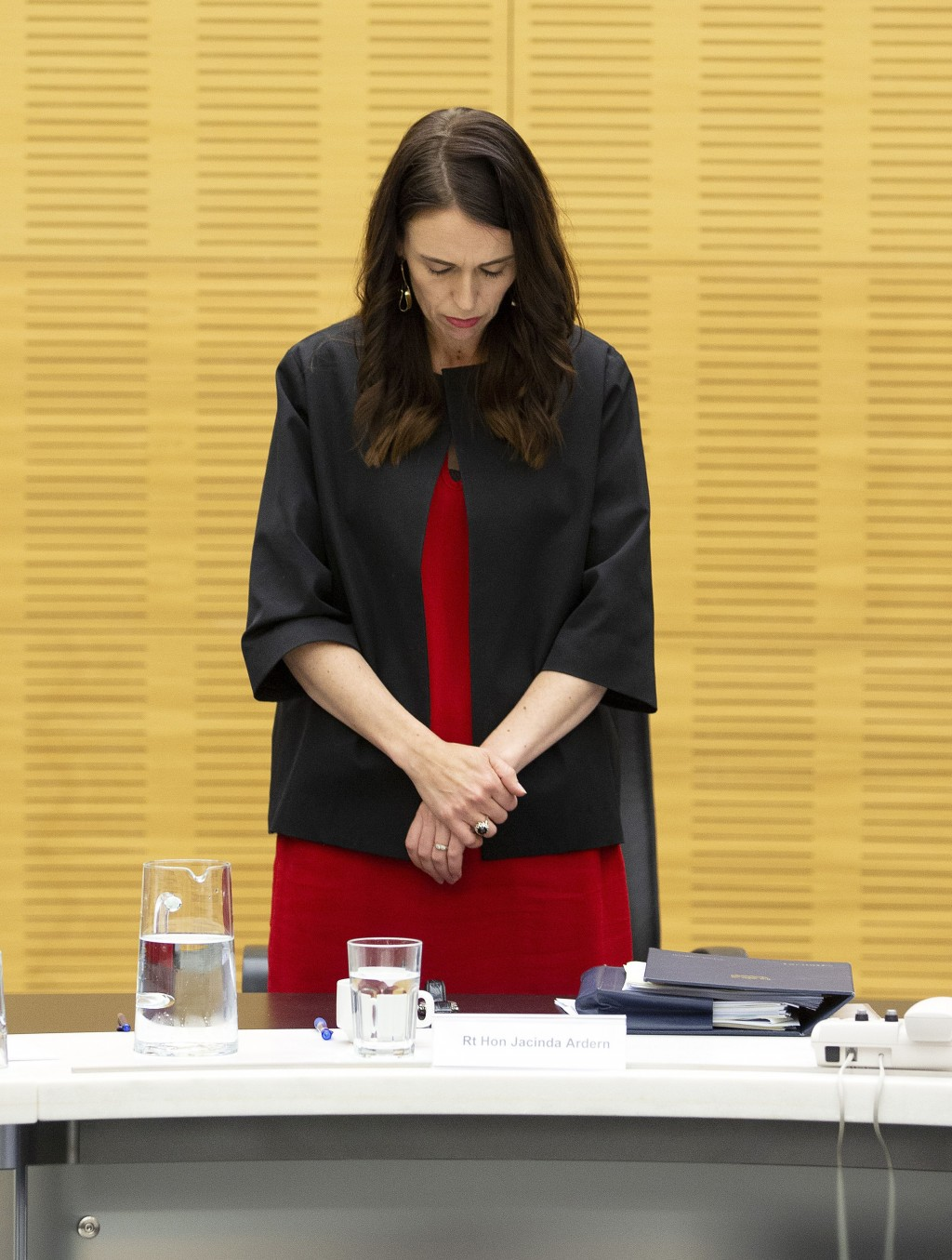 New Zealand Prime Minister Jacinda Ardern observes a moment of silence with her cabinet colleagues at the moment that a volcano erupted a week earlier...