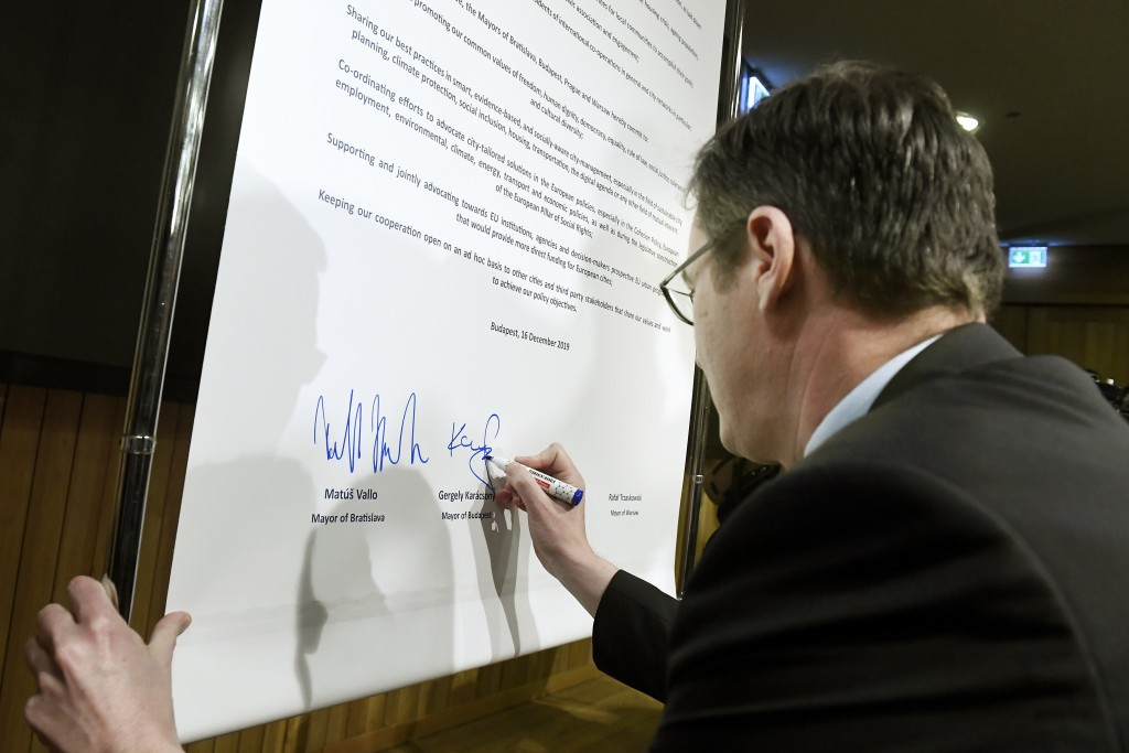 Mayor of Budapest Gergely Karacsony signs the Pact of Free Cities during a meeting of the mayors of the capitals of the Visegrad Four or V4 countries ...