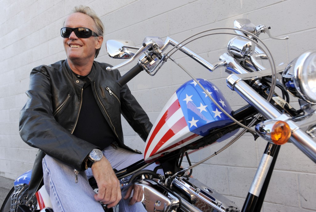 FILE - In this Oct. 23, 2009, file photo, Peter Fonda, poses atop a Harley-Davidson motorcycle in Glendale, Calif. Fonda, the son of a Hollywood legen...