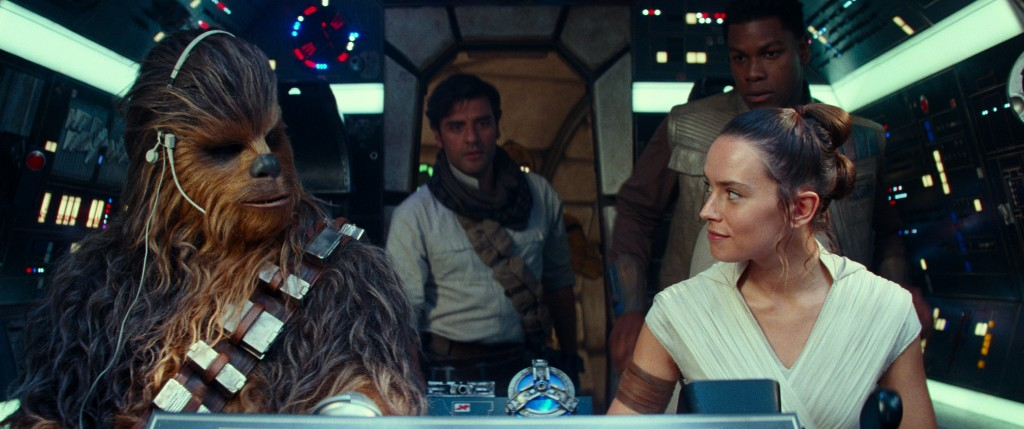 This image released by Disney/Lucasfilm shows, from left,  Joonas Suotamo as Chewbacca, Oscar Isaac as Poe Dameron, Daisy Ridley as Rey and John Boyeg...