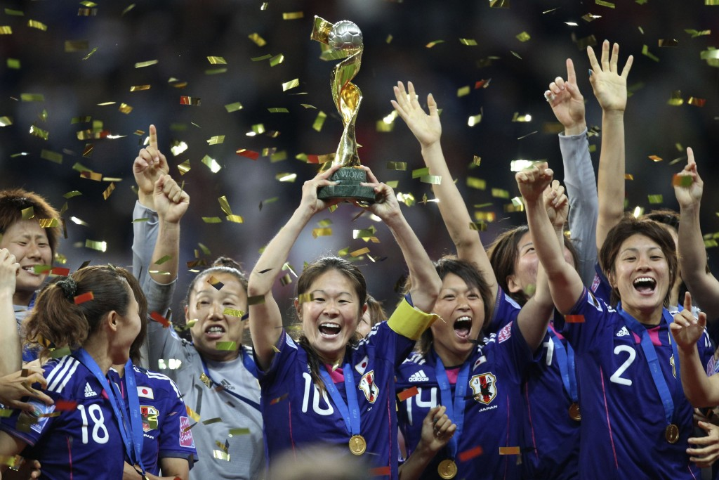 FILE - In this July 17, 2011, file photo, Japan's players celebrate with the trophy after winning the final match between Japan and the United States ...