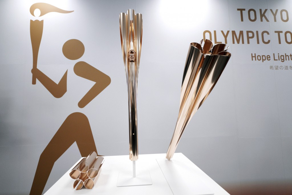FILE -  In this March 20, 2019, file photo, Olympic torches of the Tokyo 2020 Olympic Games are displayed during a press conference in Tokyo. Members ...