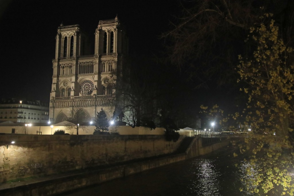 Notre Dame Cathedral is lit up in Paris, Monday, Dec. 16, 2019. The Notre Dame Cathedral has been newly illuminated last month since the April fire in...