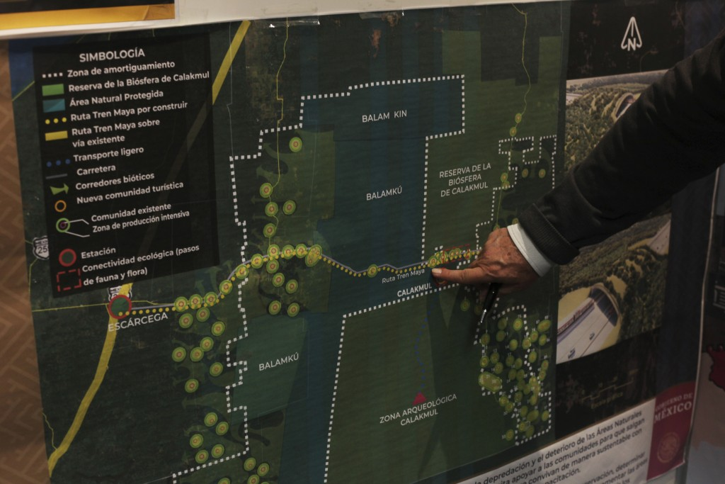 FILE - In this March 18, 2019 file photo, Rogelio Jiménez Pons, director of Fonatur, points to a map of a planned train line through the Yucatan Penin...